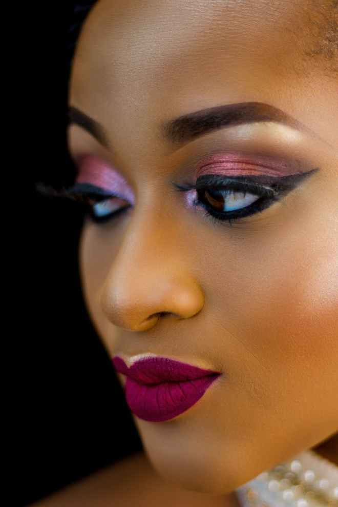 close up photo of beautiful woman in make up looking away