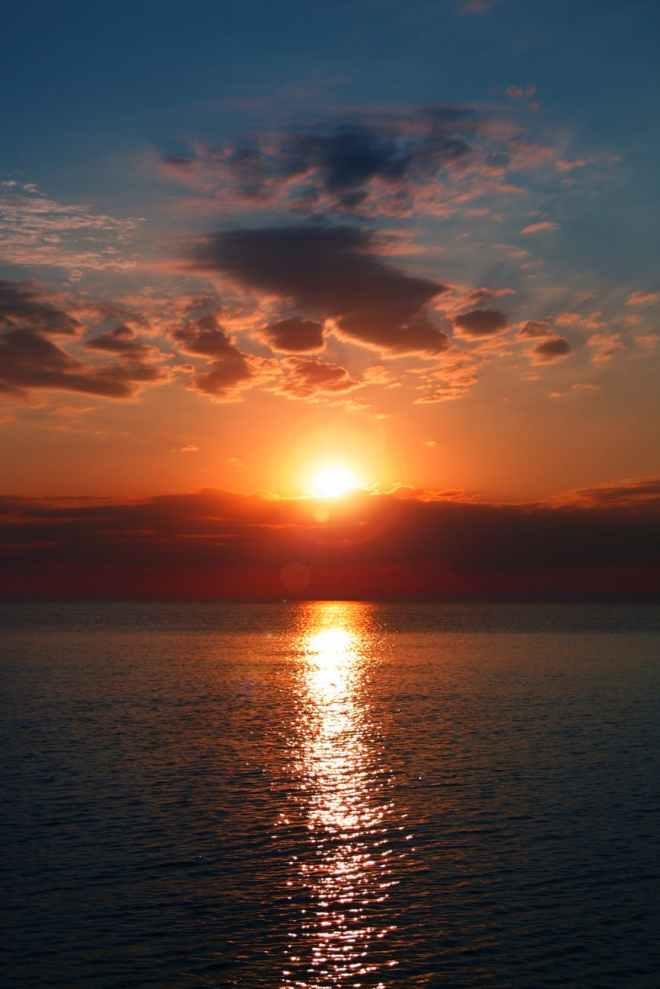 calm blue sea during golden hour